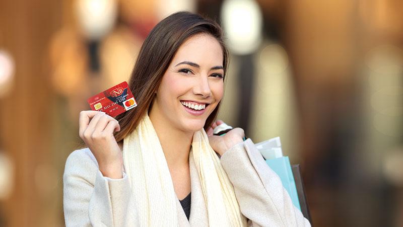 Woman holding an Ephrata National Bank debit card