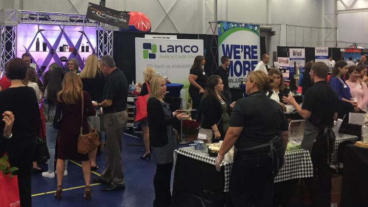 People walking among trade show booths