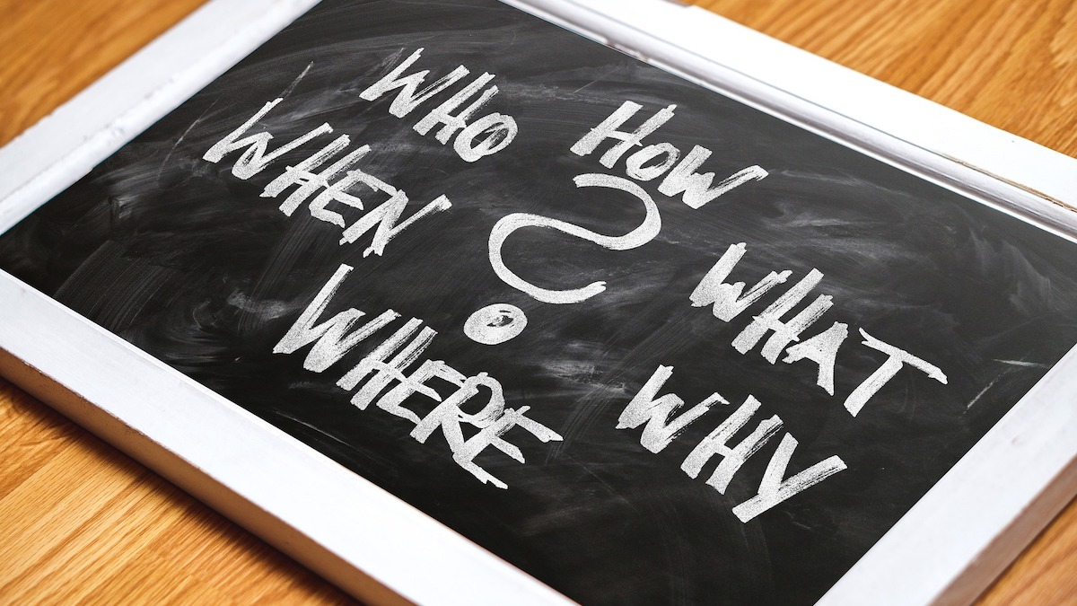 Chalkboard with questions: who, what, when, where, why, how?
