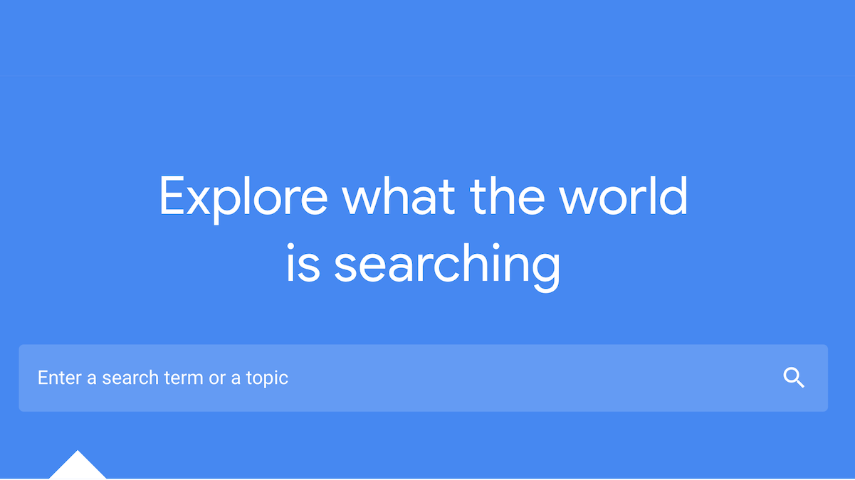 "blue search box with the words ""explore what the world is searching"" above a search bar"