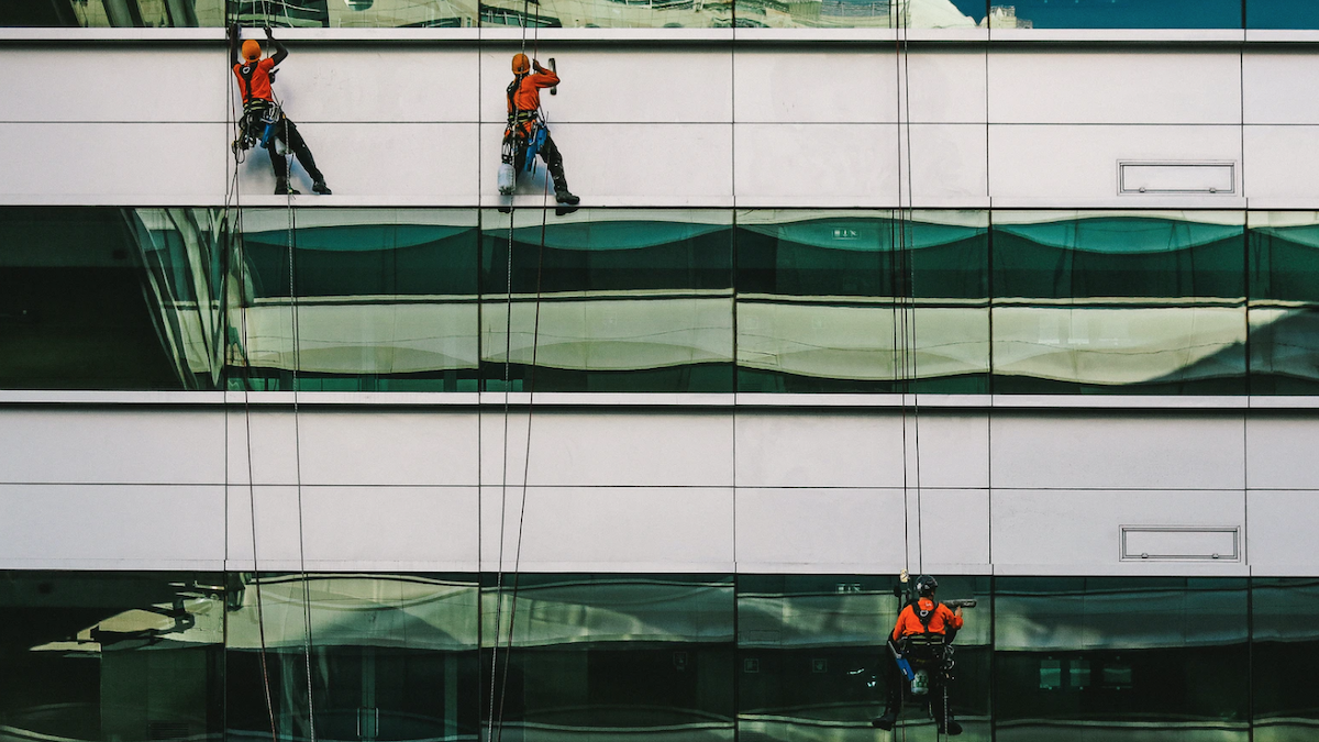 window washing crew on the side of a building